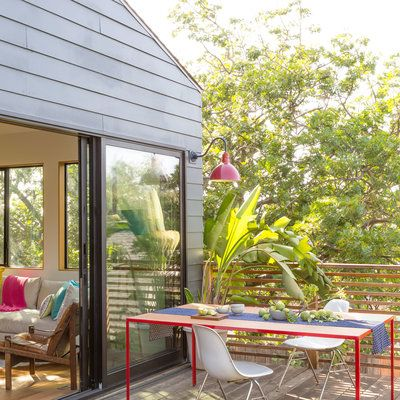 A Deck Outside A Colorful, Sunbathed Living Room Becomes One Giant Indoor  Outdoor Space