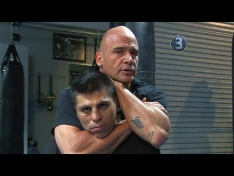 How To Perform Bas Rutten's Rear Naked Choke - Squeeze elbows together