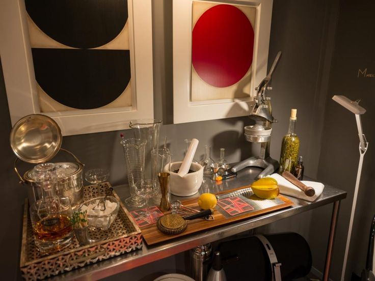 A stainless steel surgical table found at the San Francisco Decorator Showcase 2014 provides a sleek foundation for a modern bar. Topped with vintage bar accessories and bold art prints, the design is uncomplicated and smooth – just like your drink of choice.