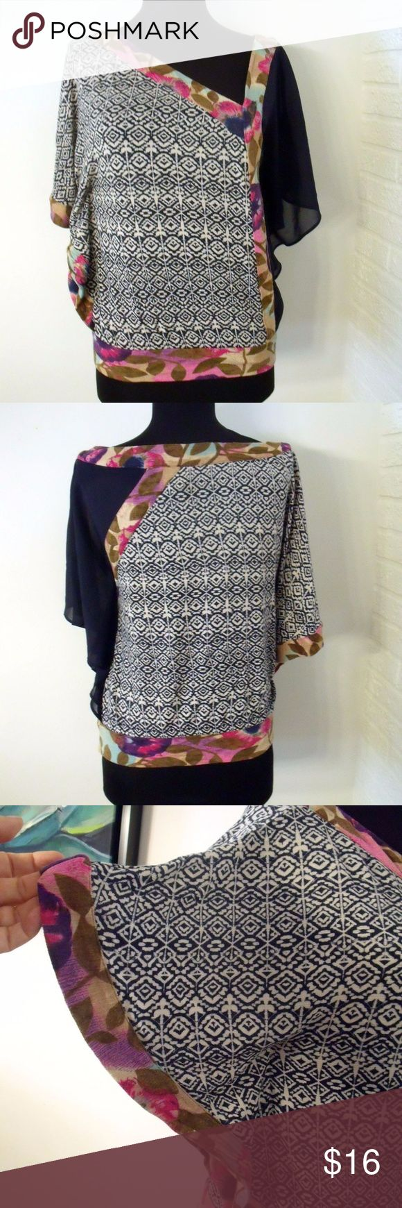 """Anthropologie Vanessa Virginia Knit Print Top Anthropologie Vanessa Virginia Knit Multi Print Blouse – size Extra Small  The unique top features an off centered V Neck with one sleeve of navy silk, a navy and cream knit pattern, and a floral pattern for contrasting trim. Batwing sleeve  PLEASE MEASURE FOR SIZE  Measurements: 19.5"""" from underarm to underarm 21"""" from the top of the shoulder to the bottom hem Anthropologie Tops"""