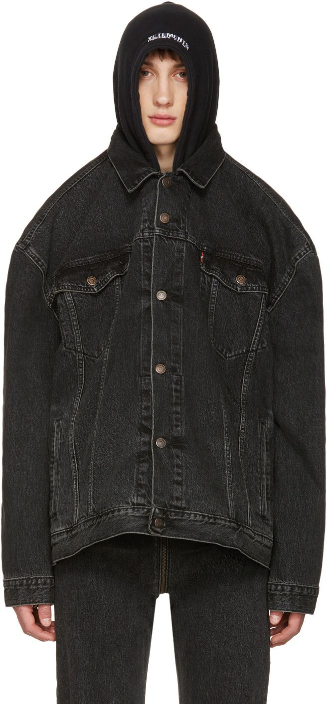 Long sleeve denim jacket in black. Fading and distressing