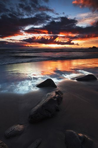 Sunrise on the black sand beach of Pololu Valley, Big Island, Hawaii