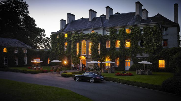 Mount Juliet House by night. Check in and enjoy the luxury of this 250 year old Georgian Manor House. Visit us online at www.mountjuliet.ie