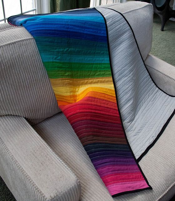 Simple rainbow quilt - Kona Solids.  Need to start collecting Kona remnants.