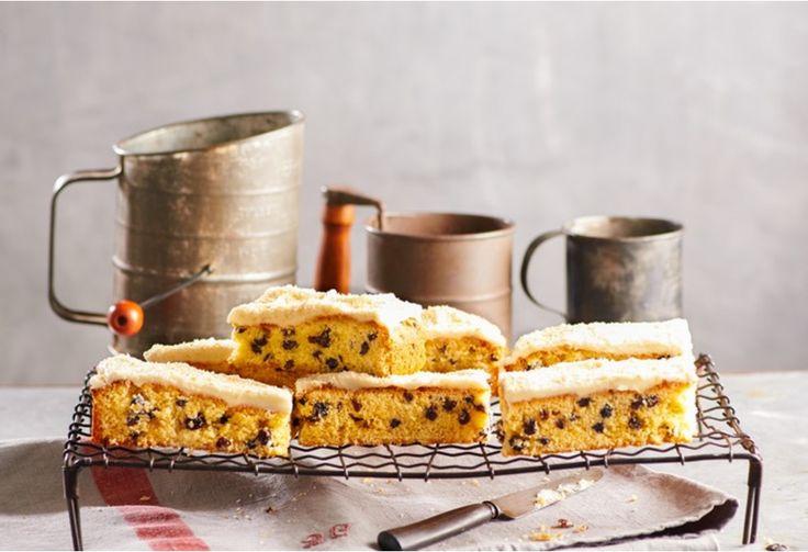 Soft moist cake slice with creamy vanilla icing.