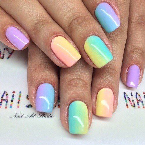 Trendy gradient nail cover is often a combination of rainbow colors. The bright choice for a summer version contains five of the seven rainbow colors: orange, yellow, green, blue and violet. A smooth transition from the color used on the little fingers to the pale orange on the ring fingers is what emphasizes dominant violet. Designed for everyday wear.