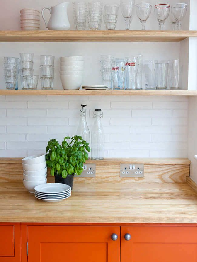 Bright orange kitchen with timber kitchens with creative decor in