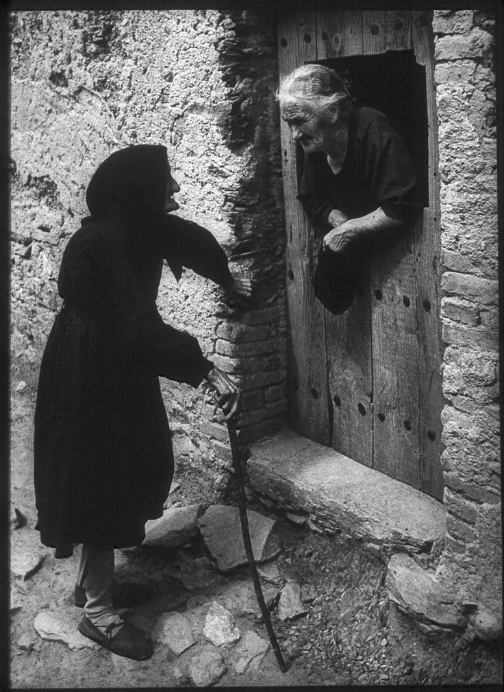 "Two Women Talking from W. Eugene Smith's photo essay ""Spanish Village"" shot in Deleitosa - 1951.......THESE LADIES COULD SPREAD MORE NEWS THAN OUR MODERN-DAY RADIO, T.V., TWITTER AND FACE BOOK ALL ROLLED TOGETHER.......ccp"