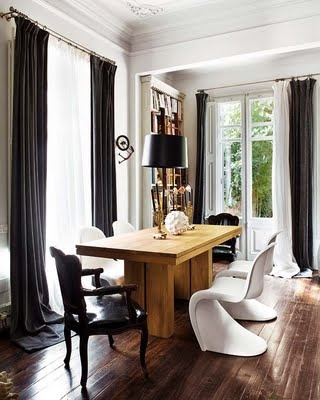 I like the mismatched chairs, both modern and traditional.