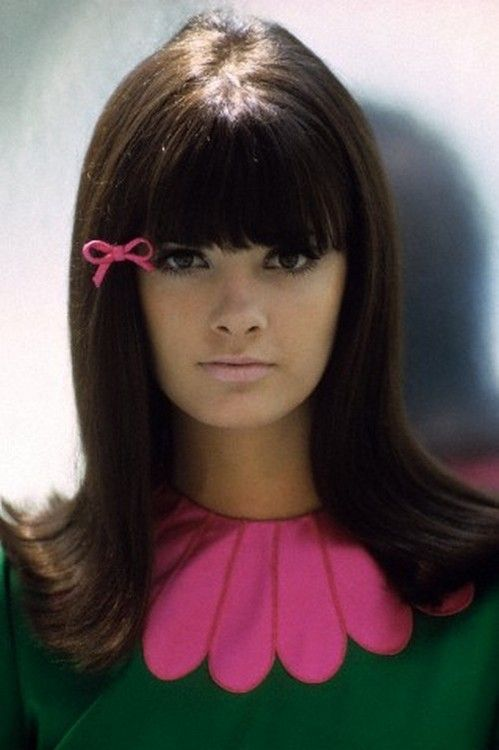 Model in green dress with big pink petal collar by Deanna Littell. Photo by Francesco Scavullo, 1965.