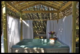 Romantic getaway in Wimberly, Texas. Each cottage has it's own hot tub.  Judy Hartman / CC