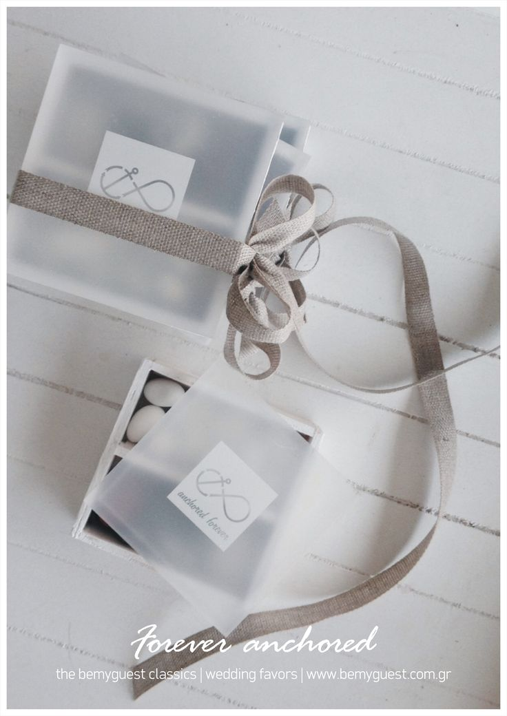 Forever anchored! | Say I Do in Santorini | modern minimal white favor boxes | handcrafted wooden boxes with plexiglss filled with draggee and edible pebbles wrapped with linen ribbon | weedding giveaway gifts designed by www.bemyguest.com.gr