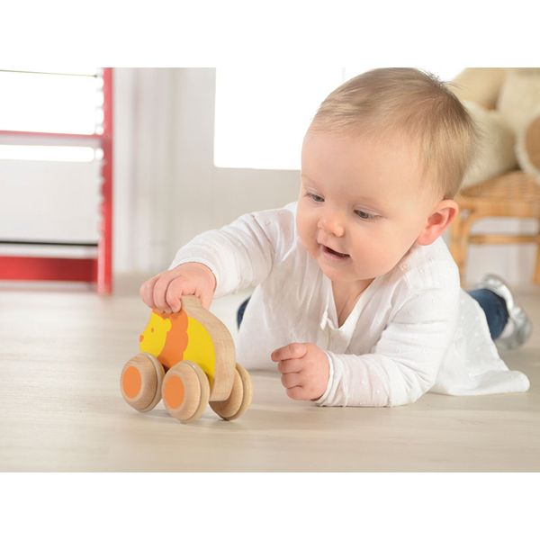 Adorable lion-shaped push along toy made of FSC certified European beech. A perfect toy for baby who starts to grasp, hold and push objects.