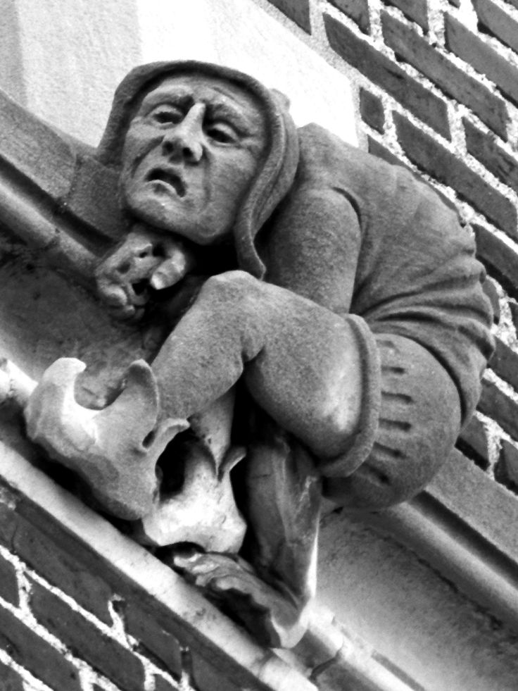 A Determined Grotesque Creeps Carefully Along the Ledge of the Worcester Polytechnic Institute Gymnasium