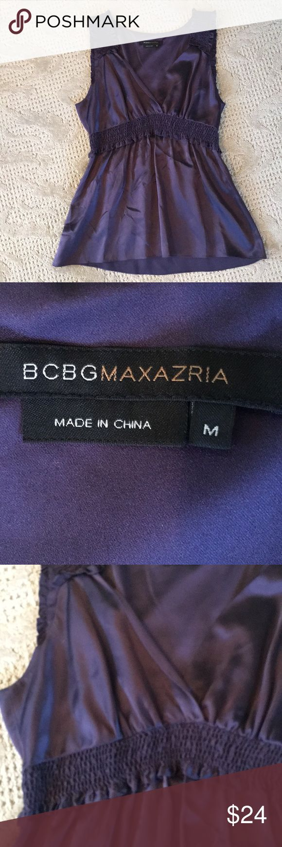 BCBGMaxazria silk top VGUC. No defects noted. Amethyst color. Stretchy smocking at waist.  V neck. Pullover style BCBGMaxAzria Tops