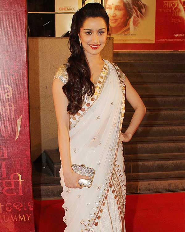 Looking resplendent in a white saree
