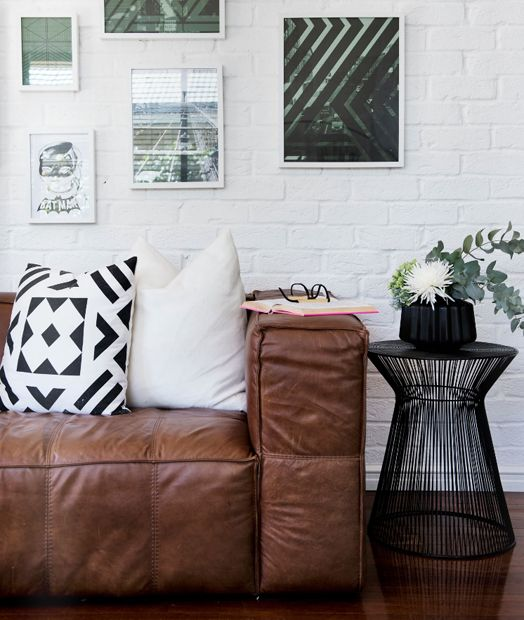 Oh that leather!! Digging the prints, cushions and exposed brick also.