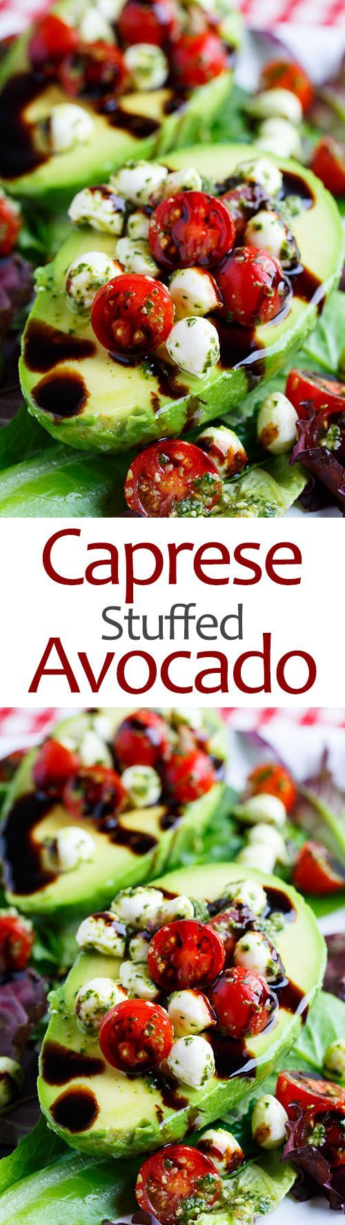 Caprese Stuffed Avocados stuffed with fresh tomatoes and mozzarella tossed in basil pesto and finished with a drizzle of balsamic vinegar.