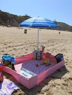 A fitted sheet with bags, coolers, etc. at the corners to keep the sand out.