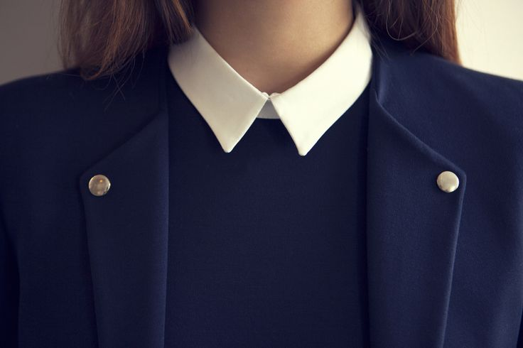 Perfectly Pristine Symmetry - navy blue blazer and white collar; close up fashion details