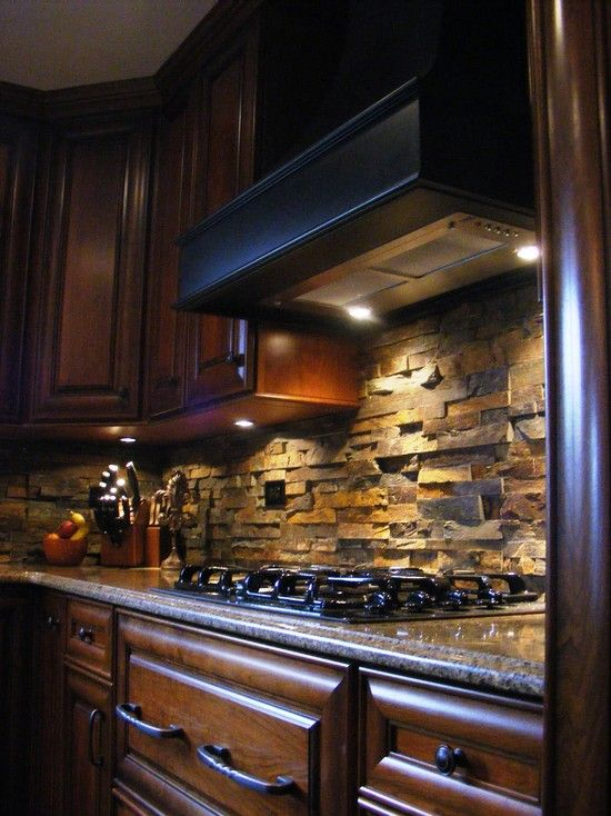 Stone backsplash and dark wood cabinets. Purely gorgeous
