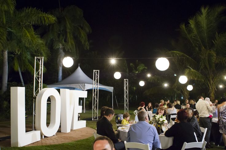 Outdoor Wedding Reception - Mercure Townsville - Lakeside Lawn - Tropical Gardens - Photo Credit: Stephen Lane Photography