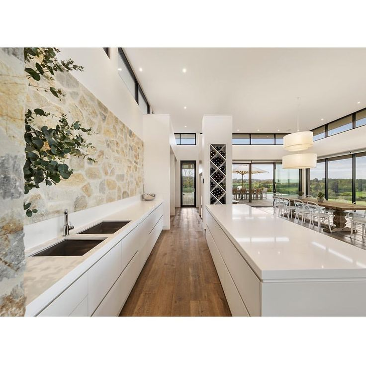 Love the beautiful stone in this chic kitchen  This stunning home in Merricks North goes by the name 'Highfield' and is for sale on Domain.
