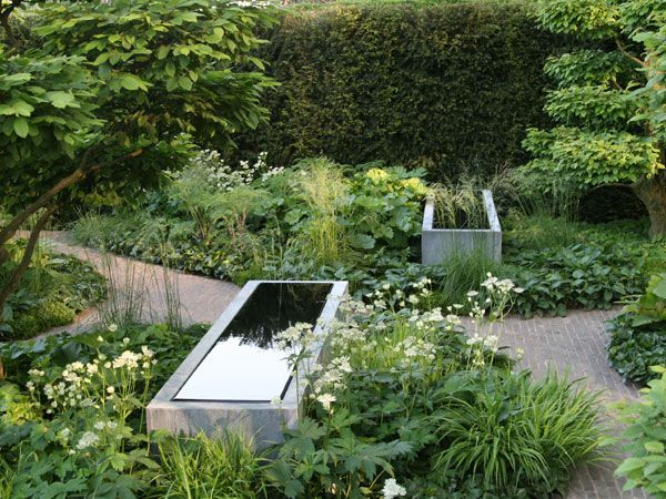 Tom Stuart-Smith. Would love a lush garden like this. The troughs are very pretty water features.