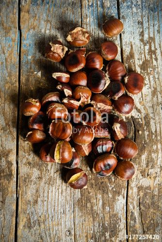 """Download the royalty-free photo """"Roasted chestnuts on old wooden table. Top view. Autumn background """" created by stillforstyle at the lowest price on Fotolia.com. Browse our cheap image bank online to find the perfect stock photo for your marketing projects!"""