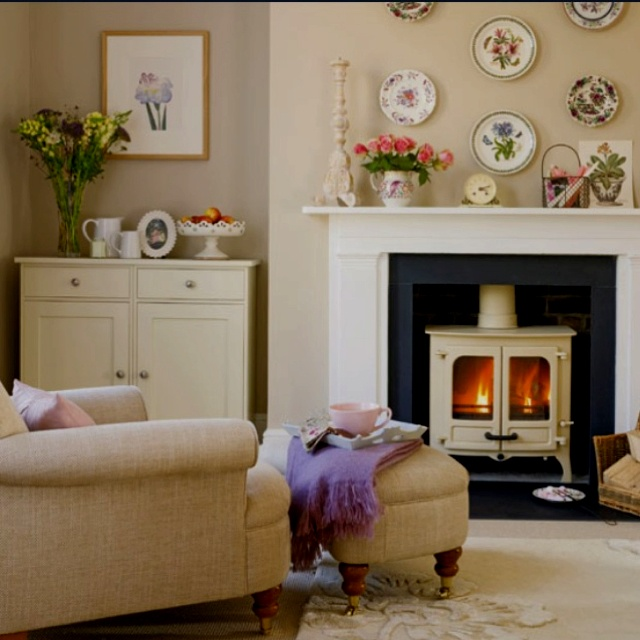 Comfy living room ~ love the white wood burning stove inside the fireplace.