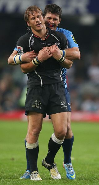 Morne Steyn of the Vodacom Bulls has a joke with Charl Mcleod of the Sharks after the Super Rugby match between The Sharks and Vodacom Bulls at Kings Park on May 25, 2013 in Durban, South Africa.
