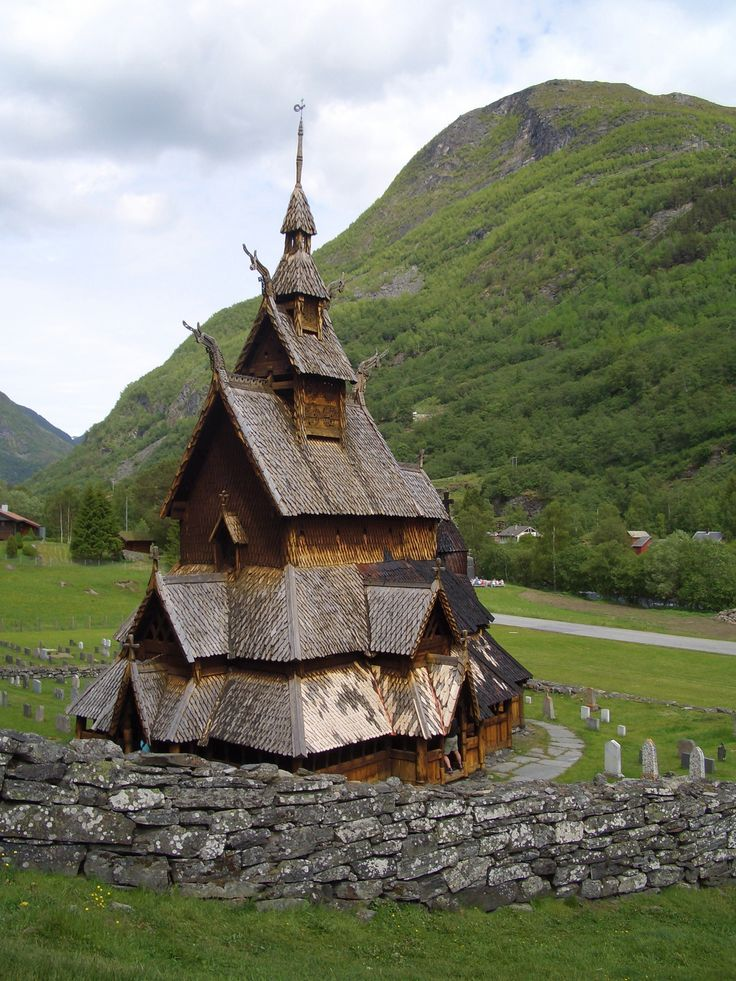 """Borgund Stavkirke, Lærdal, the best preserved of Norway's 28 surviving stave churches. Built of upright timbers between 1180 and 1250 AD, it melds pagan Viking and Christian elements and reflects the Norse world's transition. The roof crests end in four carved dragon heads, recalling the prows of Viking longships. Runic inscriptions include """"Ave Maria."""""""