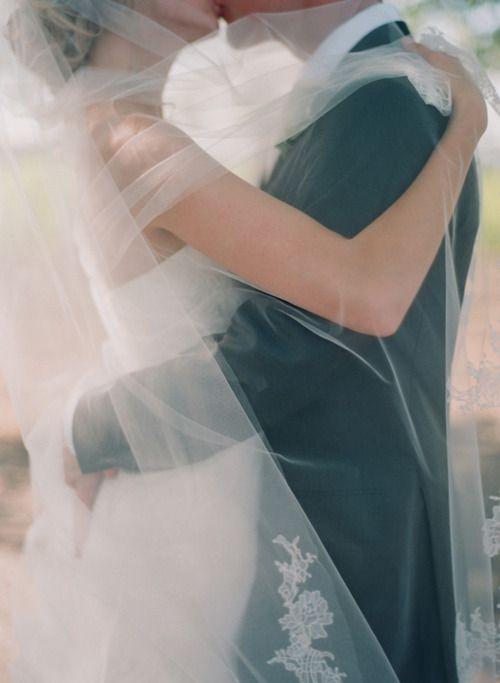 this photo makes me want a big veil so I can wrap my hubby up in it. aww.