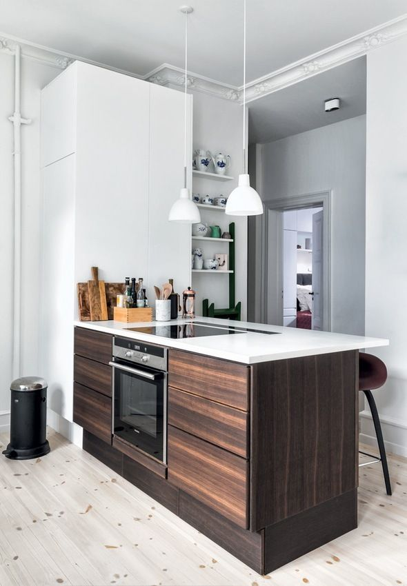 Elegant and modern kitchen in smoked oak is from Muliform with details in marble and stoneware.
