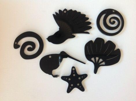6-pack of small New Zealand decorations (1 kiwi, 1 fantail, 1 pohutukawa, 1 starfish and 2 koru) in 'all black' acrylic from The Summer Christmas Company