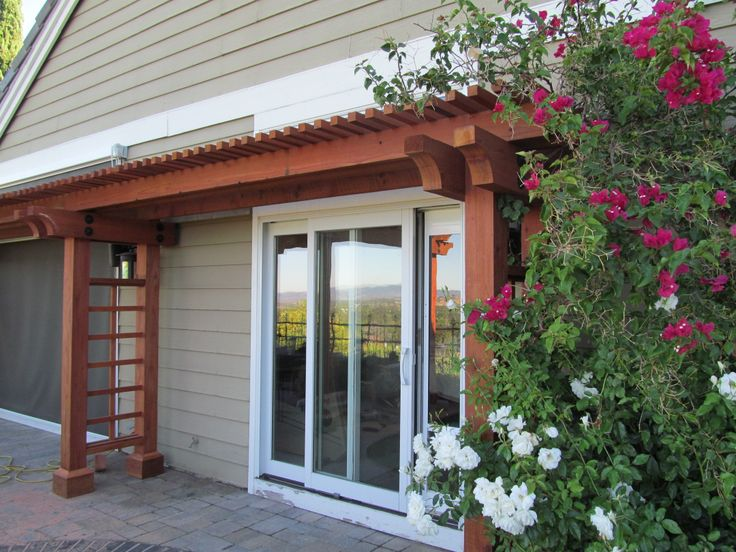 Redwood Trellis With Bougainvillea Vine Attached Installed