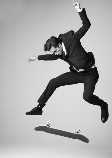 "Business dress but skateboarding - juxtaposing social connotations (""Grown up"" and ""youthful"") combined in one photo of a single person.  Dylan Rieder / Skateboarding."