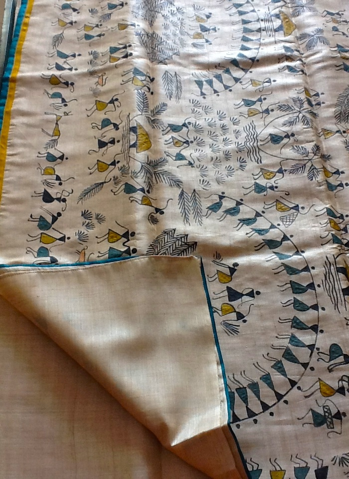 Handpainted warli in tussar silk saree with yellow and blue border! A beautiful saree and a master piece !