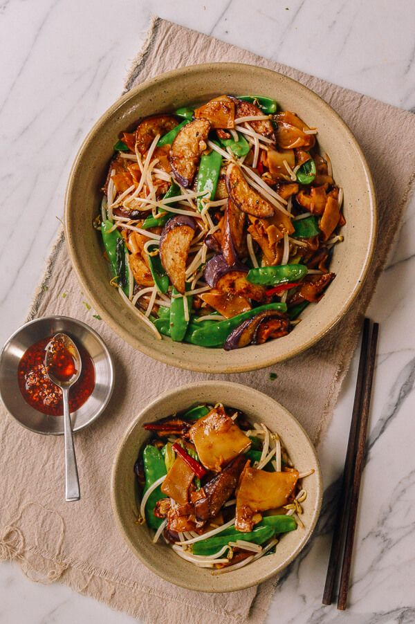 This Vegetable Chow Fun recipe is one for all the vegetarian Woks of Life readers out there! Sometimes the meat-eaters get it all: Beef Chow Fun, Pan Fried Noodles with Chicken, etc, etc. To date, one of our only other vegetarian/herbivore-friendly Cantonese noodle dishes is Cantonese Soy Sauce Pan Fried Noodles––and it's always been one …