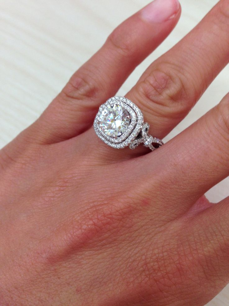 """Picture of Kirk Kara 18K White Gold Double Halo """"Pirouetta"""" Engagement Ring with 0.84 Carat Round Cut Diamonds Featuring Bow Tie Designs on Each Side of Engagement Ring."""
