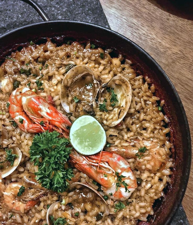 #Bali. Que Rico! This world famous dish that originated in Eastern Spain Valencia is a true Spanish classic.  Who doesn't love the Seafood Paella? Savor delicious prawns fresh succulent clams and tender squid on a bed of soft seasoned rice.  You can now enjoy this delectable favorite by individual order at @LaFincaBali!  How amazing is that?