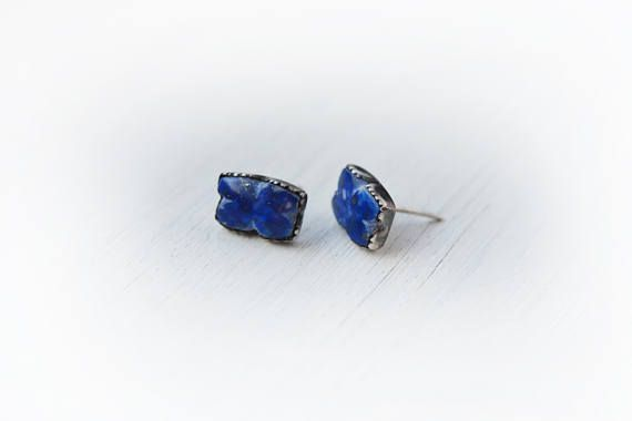 This is a sterling silver (hallmarked) and lapis lazuli earring made in my studio. The lapis lazuli is natural, hand carved into a rustic butterfly shape! The setting is sterling, and has been cut to a zigzag freeform design on the top. The earring has lots of patina for enhancement. It comes with plastic backs .   Size: 8x12 mm wide  Please check out my other items too, I hope one of them has your name on it!  I always search for the most inspiring gemstones and raw materials, choose extra…