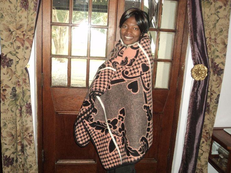Angela models how to wear a Basotho Blanket. Watch the stripe