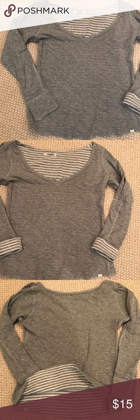 Aritzia 'TNA' Long Sleeve Reversible Top A great basic and essential piece to add to your collection, this TNA long sleeve is super comfy and cozy with its cotton material and stretch fit. Wear it however you like and you can even fold sleeves back for a stylish contrasting color look! Looking for layering pieces to add to your fall wardrobe or for back to school? Well, this reversible top is perfect for you! Check out the other colors we have this top in as well! Worn with love and still in…