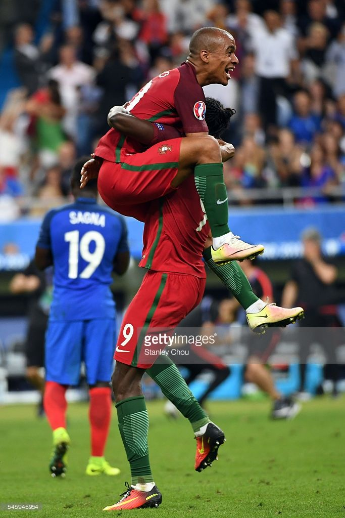 João Mário and Eder of Portugal celebrates after their 1-0 win against France during the UEFA EURO 2016 Final match between Portugal and France at Stade de France on July 10, 2016 in Paris, France.