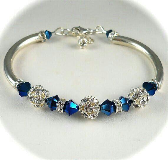 Blue Swaroski beads and silver bracelet.