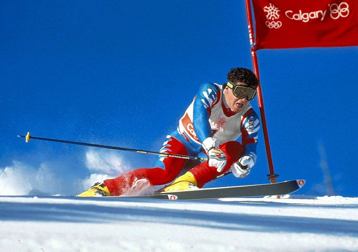 """Alberto Tomba, Italian Alpine Skier, competing in the Super Giant Slalom at the Calgary 1988 Olympic Winter Games. After not finishing the Super-G, """"La Bomba"""" as he was known in the media, went on to win Gold in the Giant Slalom and Slalom events to cement his place as one of the superstars of the sport."""