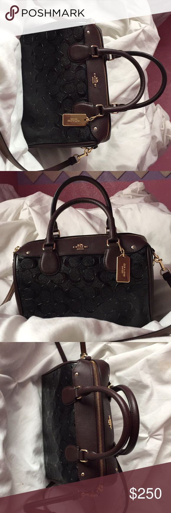 Cute crossbody bag brand Coach Really cute to take out on a date😉not to oversized and has the option to take off crossbody belt. I only have taken it out 5 times to important events. It is a really elegant looking bag makes you look classy😊 Coach Bags Crossbody Bags