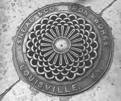 Manhole Cover. Chrysanthemum design. Louisville, KY.  Snead Iron Works.