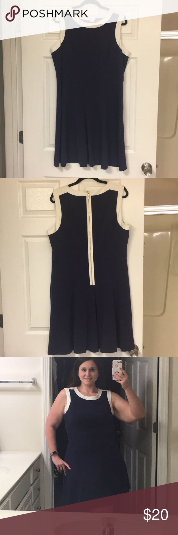 Never worn, not my style anymore. Timmy Hilfiger Navy blue sheath dress with white trim and gold zipper. Top is lined on the inside down to waste. Falls right above the knee. Tommy Hilfiger Dresses